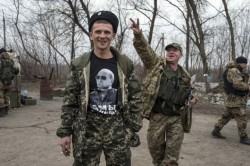 A pro-Russian rebel shows his t-shirt depicting Russian President Vladimir Putin at a checkpoint in the village of Chornukhyne near the town of Debaltseve